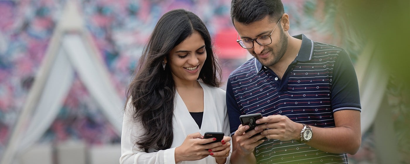 man and woman scrolling through meditation apps on smartphone
