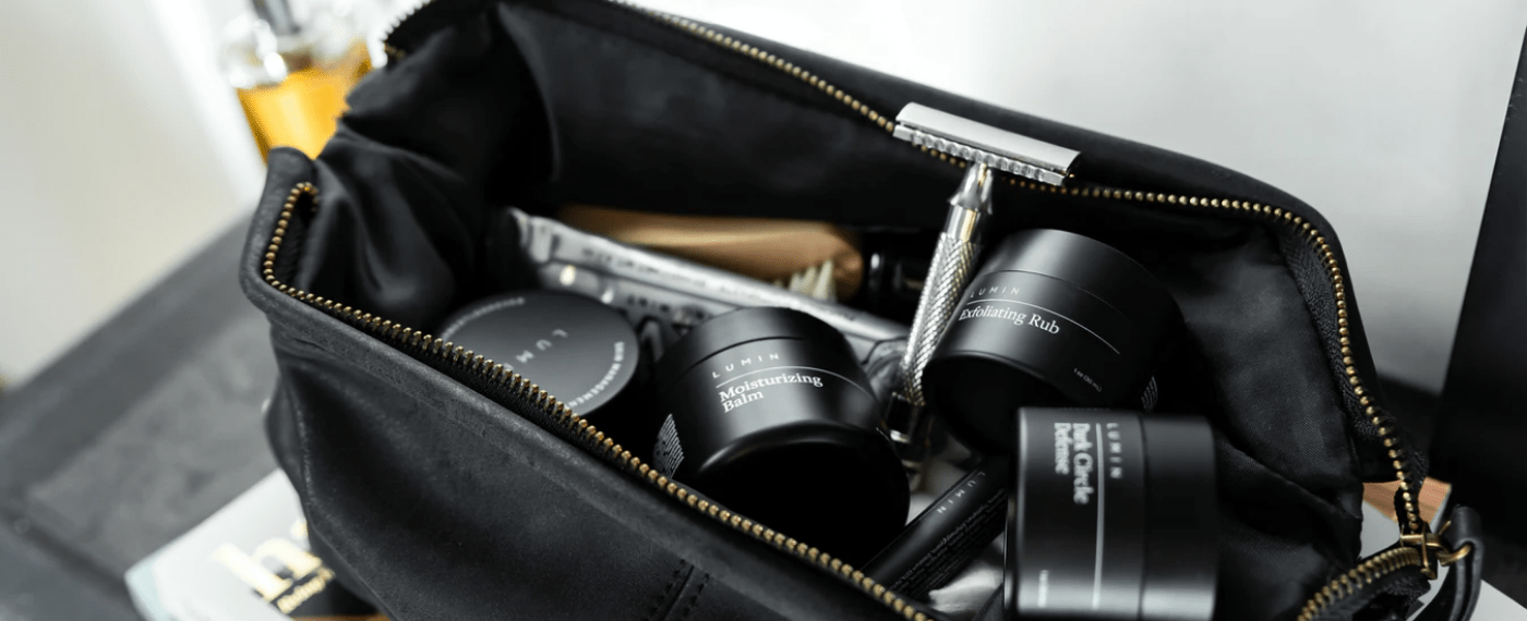 a travel bag full of luxury skincare products