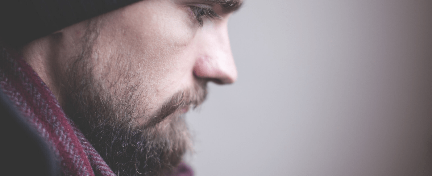 Bearded man thinking about seeking help for mental health aid