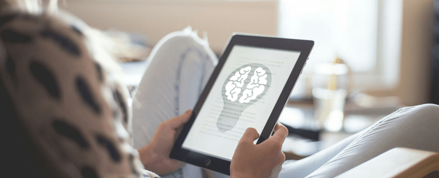 Woman reads an article about brain consciousness on her tablet