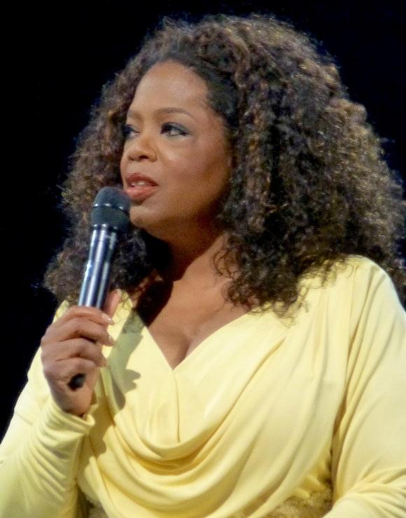 Oprah Winfrey holding a microphone