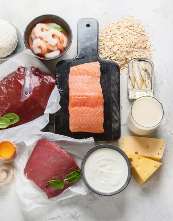 A variety of healthy foods rich in vitamin b12 such as salmon, cheese, and oats