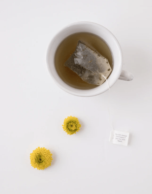 a tea bag floating in a cup of tea