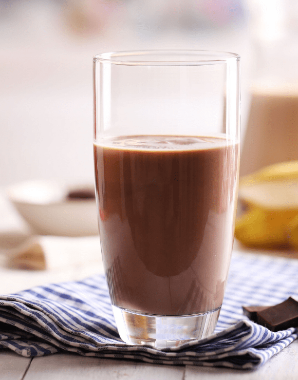 A tall glass of healthy chocolate milk