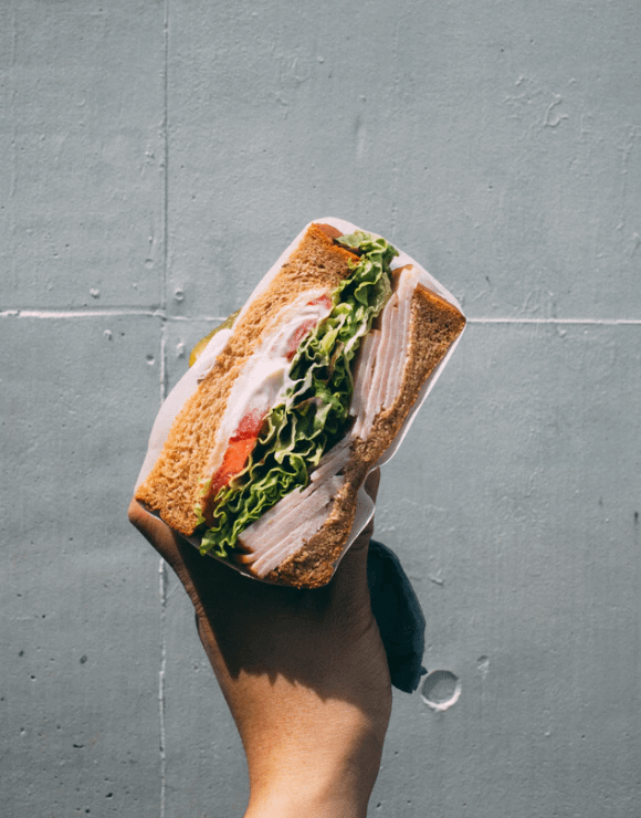Typical United States sandwich filled with deli meat, lettuce, tomato, and mayo