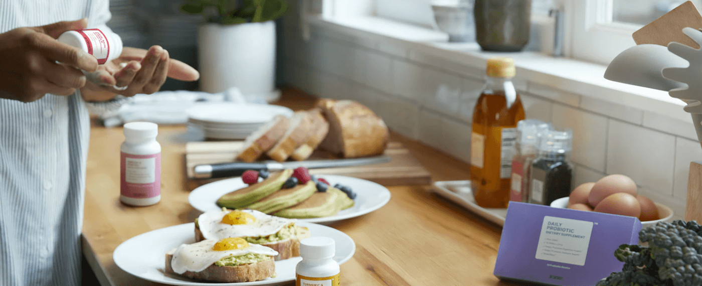 Woman taking weight pills with healthy breakfast