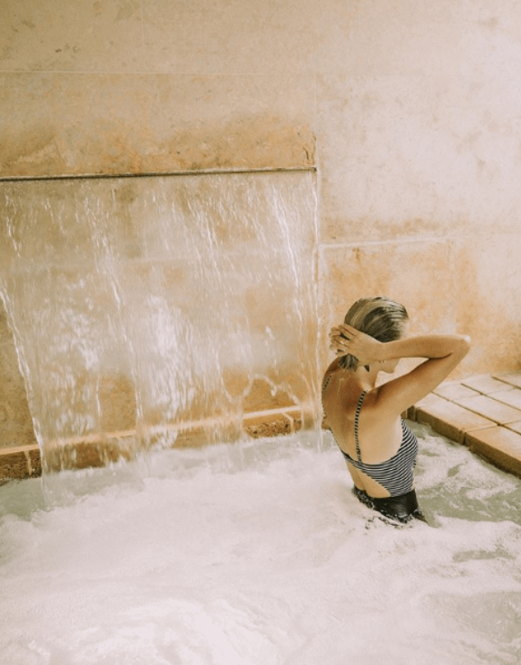 Woman relaxing in a luxury CBD spa tub