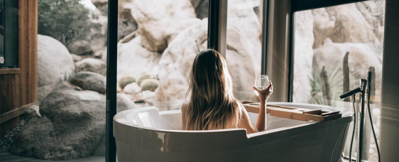 woman enjoying a cbd spa treatment in a tub